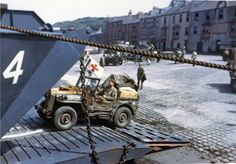 Castletown Road Slipway, Portland,  Dorset. Jeeps being driven into the open doors of an LCT in preparation for D-Day.