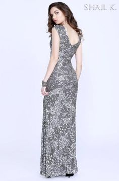 Light up the room in this dazzling evening gown by Shail K. The V-neckline bodice creates curves. Twinkling adornments and wrapped with exceptional shimmering beads, this alluring ensemble slides to the full-length hem accented with more brilliant beaded details. Model is 5'9 wearing size 6.  #dressoftheday #prom #ootd #shailkusa #fashion
