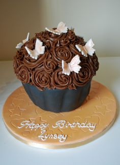 - Chocolate Giant cupcake with fondant butterflies