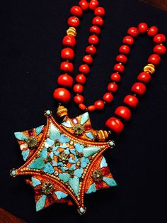 Tibetan gold gau box and coral necklace 19th century from Lhasa