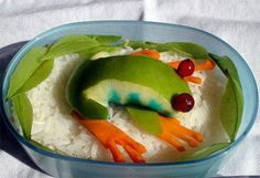 Frog made of apple and carrot slices cover this dip