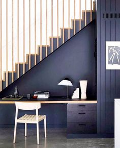 The blackbutt timber staircase with battens is paired with a clever in-built study nook underneath. The study area is painted black, creating visual integration. The concrete polished floor adds a soft contrast. Timber Staircase, Black Staircase, Concrete Staircase, Staircase Storage, Home Stairs Design, Study Nook, House Stairs, My New Room, Home Renovation