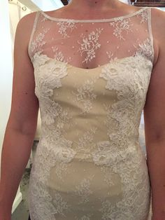This is a sexy yet traditional dress with beautiful hand sewn lace and a sweetheart neckline. The dress is a sample and has never been worn because my fiance and I eloped! The dress is in perfect condition. The dress also comes with a veil that matches the lace on the dress perfectly.