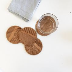 Laser cut wood coasters with a scallop striped motif.
