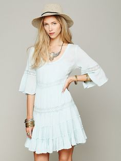 Shapeless day dress w/floral lace tripping. Those bell sleeves!