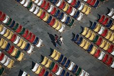 People walk through an aisle of deckchairs in Strasbourg, eastern France