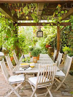Define your outdoor dining area with a pergola. Not only will it make your dining area cozier for your guests, but the overhead covering will provide welcome shade on hot, sunny days. Hang a few lights from the pergola for finished looked that will allow you to continue using the space after the sun sets./