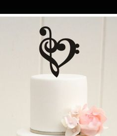 Music Note Cake topper - https://www.etsy.com/listing/164858415/custom-wedding-cake-topper-music-note