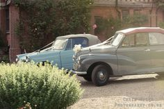 two vintage wedding cars
