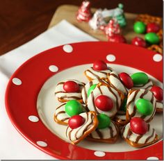 Christmas finger food~Hardest part is to find the round pretzels. I make these with my niece & with the kids in my classroom & they are a hit with everyone!!!! Haven't seen someone turn one away :)