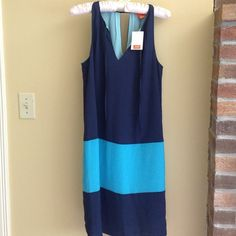 Beautiful navy and aqua dress Beautiful.  Soft. Flowy. Perfect for the office or a summer day. Joe Fresh Dresses