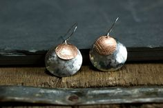 Domed Silver and Copper Earrings by RootsAndWingsJewelry on Etsy, $46.00