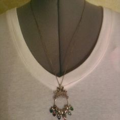 Sweet necklace Measures about 13.5 in long.  Silver necklace with  birthstone apple charms. Avon Jewelry Necklaces