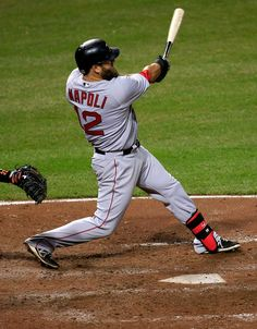 Mike Napoli Mike Napoli #12 of the Boston Red Sox follows his two RBI single against the Baltimore Orioles in the seventh inning of the Red ...