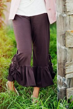 "Like a nice cup of cocoa on a cold day. Slip into these pants for both comfort and style. A slimmer style of leg than our big ruffles last year with the same 2 length options available. Fully loaded with 5"" comfort yoga waist band."