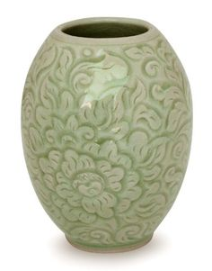 NOVICA Floral Celadon Ceramic Vase, Green, 'Thai Peony'. Size: 4.3 in. H x 3.3 in. Diam. Authentic: an original NOVICA fair trade product in association with National Geographic. Certified: comes with an official NOVICA Story Card certifying quality & authenticity. Exceptional Artisan Quality by Kanda - crafted with care to be treasured for years to come. Product Info: Celadon ceramic.