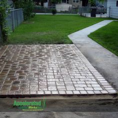 Try pavers to add texture and color to your backyard instead of more dull concrete. This is a traditional random cobble pattern with a soldier course border and finished with wet-look sealer. Concrete Driveway Pavers, Paver Designs, Wet Look, Pathways, Sidewalk, Backyard, Driveways, Traditional, Fire Pits
