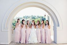 Bridesmaids in fluffy pale pink dresses with fluffy pale pink cotton candy // Anaheim Hills Golf Course Clubhouse | Images by Palos Studio
