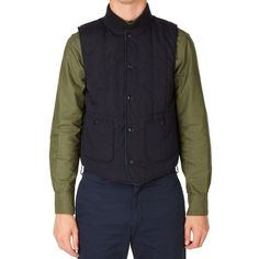 The Fridge Vest is typical of Engineered Garments designer Daiki Suzuki's innovative approach to clothing and his fundamental understanding of the balance between complexity and simplicity within design. An otherwise subtle design, this cold weather essential is constructed from cotton mix poplin with a full plaid lining, two patch pockets and a full stud closure. Suzuki manages to take it to the next level with the addition of a full checked lining, in a subtle hit of contrast and down…