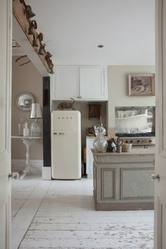 The free-standing island in the kitchen is a vintage French shop counter, which Josephine used in her first antiques shop for ten years. When she closed the shop, she brought the counter home with her. Kitchen Interior, New Kitchen, Ryan Homes, Shop Counter, Victorian Terrace, Antique Shops, French Vintage, House Tours, Tall Cabinet Storage