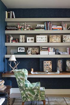 Wallpaper continues to grow in popularity. If you're reluctant to do a whole room, just cover a single wall for a pop of color, pattern, or texture. Look how Farrow & Ball used this blue paisley wallpaper to add interest and dimension to shelves. And lots of people are now papering bathrooms—you can even get humidity-resistant  paper.