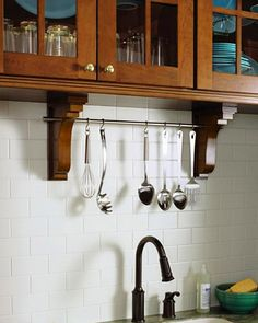 Martha Stewart Lily Pond Kitchen: Pierced Corbels. Add a simple and elegant dowel rod to keep your utensils within reach.
