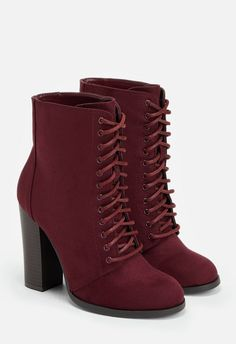 This faux suede lace-up bootie features a tall block heel, making it both ultra cool AND comfortable!...