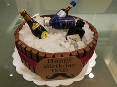 Liquor Barrel Cake for Daddy's Birthday. Decorated with Kit Kat and rock sugar as ice cubes