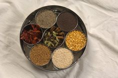 The Masala Dabba, a traditional Indian spice box, is very utilitarian in Indian kitchens. A Masala Dabba is commonly found in almost all Indian kitchens.