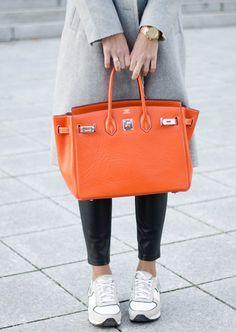 kristjaana mere orange hermes birkin bag leather pants white sneakers winter style