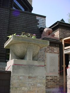 Sculpture and urn outside Wright's studio