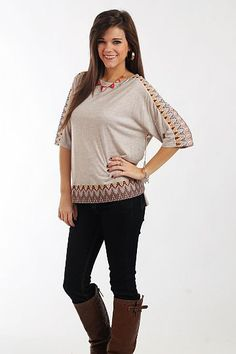 """The Nahla Top, Taupe $37.50  This top is sure to become one of your favorite pieces in your wardrobe! The taupe material is soooo soft and this piece is slightly loose-fitting to drape nicely. Our favorite part is the patterned fabric on the shoulders and hemline... too cute!   Fits true to size. Miranda is wearing a small.   From shoulder to hem:  Small - 24""""  Medium - 24.5""""  Large - 25"""""""