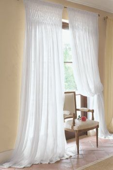 "Sheer Curtains with honeycomb smocking and extra length, ~12"". Experiment with smocking placement, either (a) at the top, overlapping both wall and window as in this picture, or (b) with an equal solid space in front of the wall and the band of smocking only over the window."