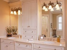 Tall plate glass mirror w/ shallow cabinet between; fixtures installed over glass