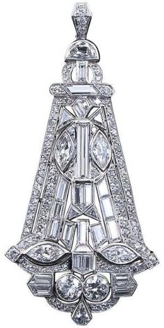 Art Deco Fancy Shapes Diamond Kite Shaped Pendant. A fabulous diamond in platinum pendant from the Art Deco period contains approximately ten carats of fancy and calibrated cut diamonds. Includes two old European cuts of 1.0 carats total weight and four marquise shapes of 2.00 carats total weight. by fannie