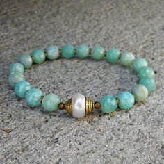 Amazonite gemstones, African trade beads, and Tibetan capped pearl guru bead mala bracelet.