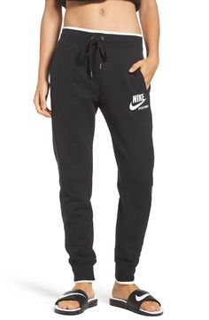 A bonded side-zip pocket furthers the streamlined silhouette of modern dropped-crotch jogger pants pieced together from cozy cotton-blend tech fleece in a tapered leg that ends with on-trend banded cuffs at the ankles. Nike Fleece, Tech Fleece, Fleece Pants, Knit Pants, Nike Fashion, Fitness Fashion, Drop Crotch Joggers, Pretty Outfits, Cute Outfits