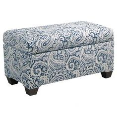 Paisley-upholstered storage bench with a solid pine wood frame. Handmade in the USA.     Product: Storage benchConstruction Material: Pine, metal, fabric and polyurethane foamColor: Arta indigoFeatures:  Hinged topHandmade in the USA Dimensions: 18.5 H x 38 W x 18 DNote: Assembly requiredCleaning and Care: Spot clean only