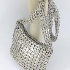 Small zipper purse in silver. $45.00, via Etsy.