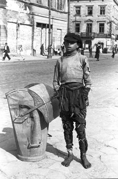Warsaw, Poland, A boy in a ghetto street.  One of the photographs taken by the German photographer Willi George over the course of a single day in the summer of 1941. The photographs are unique in that they were not staged, but showed the ghetto as it truly was.