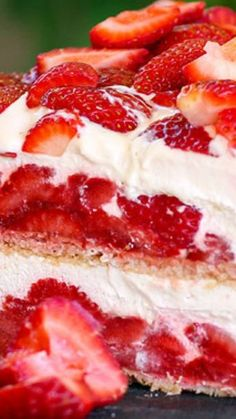 Strawberry Shortcake No-Bake Ice Box Cake ~ Layer upon layer of cookies, cream and luscious strawberries make up this insanely simple and delicious no-bake strawberry shortcake ice box cake recipe... The fabulous vanilla whipped cream frosting will certainly knock your socks off.