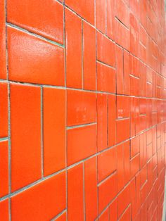 Spice up your kitchen or bathroom with a nice orange tile.
