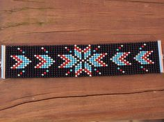 A personal favorite from my Etsy shop https://www.etsy.com/listing/575009561/native-american-bead-loom-bracelet-black
