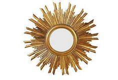 A nod to midcentury style, this stunning sunburst mirror features a gleaming gold finish.