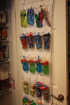 Bottle/Sippy Cup storage using over the door vinyl shoe holder!! Wonder if I could do thing in a cabinet ?