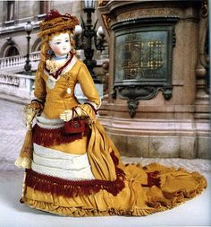 19th Century Fashion Doll by Simonne Paris c.1877-78.  Creepy doll, but beautiful dress.