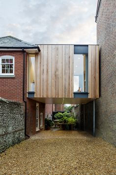 British architect Adam Knibb has extended a house in a converted school in Winchester, England, by building a timber box above a seldom-used entryway.Adam Knibb Architects was asked by the owner to … Architecture Extension, Residential Architecture, Interior Architecture, Interior And Exterior, Interior Design, Wooden Cladding, Wooden Slats, Architects Journal, Extension Designs