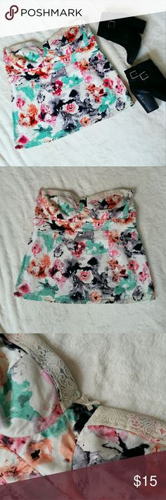 """Torrid Watercolor Strapless Blouse This pretty blouse is a vibrant watercolor pattern with lace and bow embellishments. Had removable straps that are now missing. Front bust area is padded. Torrid 1 = 1x according to Torrid size charts. Zipper back closure and elastic so it can slightly stretch. 17"""" across the top, 18"""" in length. Excellent condition besides missing straps. torrid Tops Blouses"""