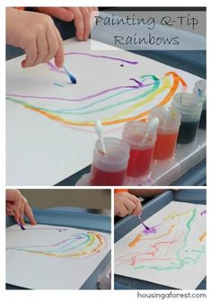 Painting Q-Tip Rainbows ~ fun painting technique that your kids will love.  No need for paint brushes!