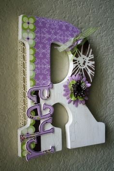 super cute decorated letter and name great to hang outside a kids door :)